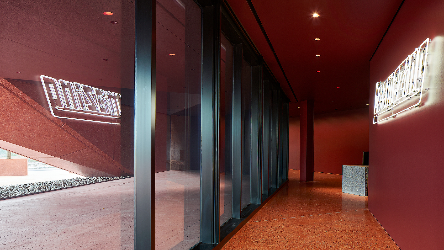 red lobby space at ruby city dror baldinger architectural photography